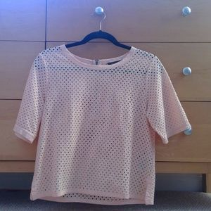 pink shirt with hole design pattern